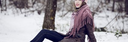 Beautiful young woman in fashion winter clothes